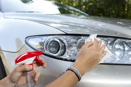 Cleaning car headlamp, close up  Stock Photo