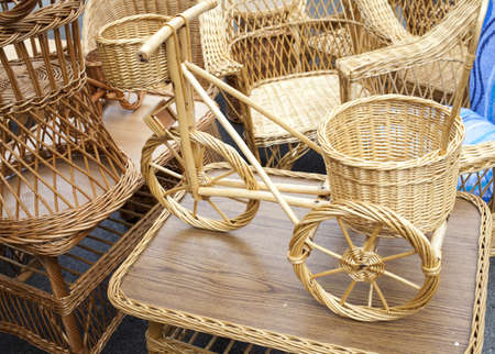 Wicker bicycle and furniture made from organic osier rod, on outdoor market  photo