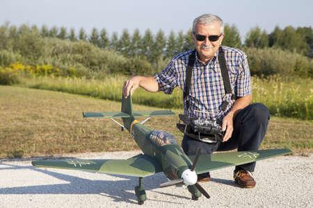 Senior RC modeller showing his new scale plane model