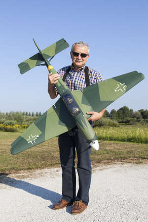 Senior RC modeller showing his new scale plane model Stock Photo - 21512683