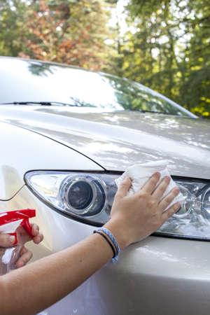 Cleaning car headlamp, close up  photo