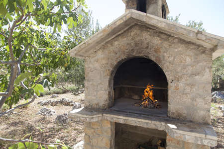 Fire in traditional rich bbq fireplace, made from stone brics Stock Photo - 22108326