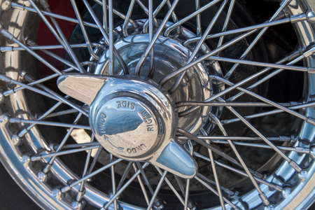 Shiny bright, Polished chrome wire wheels and spinners of a classic vintage sports car, close-up photo
