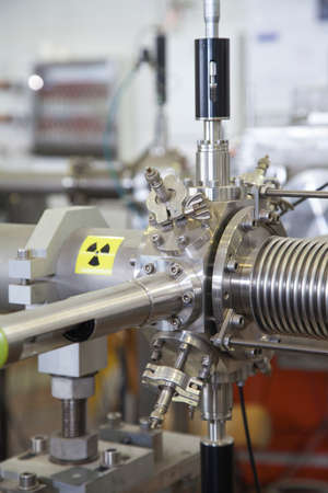 machined: View of important electronic and mechanical parts of ION Accelerator, with high radiation warning  sign, CNC machined parts, selective focus