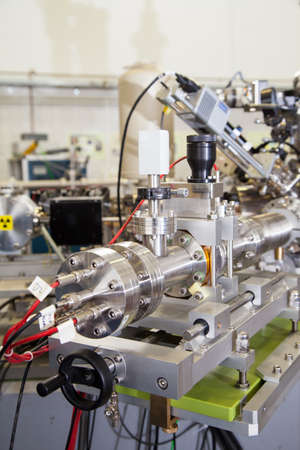 machined: View of Important electronic and mechanical parts of Mass spectrometer in ION Accelerator command room, CNC machined parts, tilt shift lens, selective focus