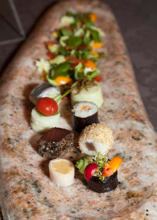 Close up of tasty Fruits of the sea canapes on a Mediterranean marble plate-selective focus  photo