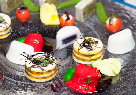 Close up of tasty Fruits of the sea canapes and dessert decoration -selective focus photo