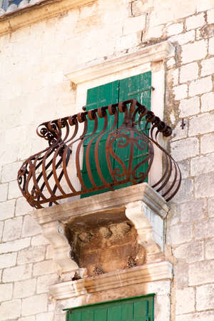 Beautiful balcony, hand maded from steel, on an old Mediterranean house  photo