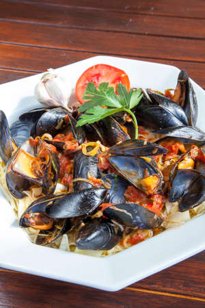 mussle: Pasta with Mediterranean mussels in tomato sauce with fresh herbs