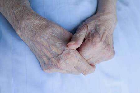arthritic: Old wrinkle hands of 93 years old lady, close up, selective focus, series of high resolution photos