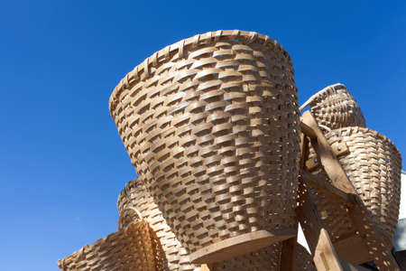 handimade: Handmade traditional straw wicker baskets on sunny market,   against blue sky