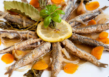 Tasty Marinated sardines with Mediterranean herbs, close up Stock Photo