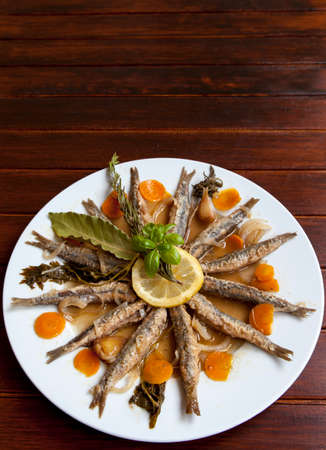 Tasty Marinated sardines with Mediterranean herbs, close up, space for text photo