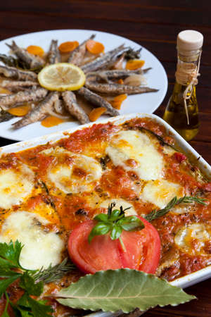 Melanzane alla Parmigiana and Marinated sardines in background photo