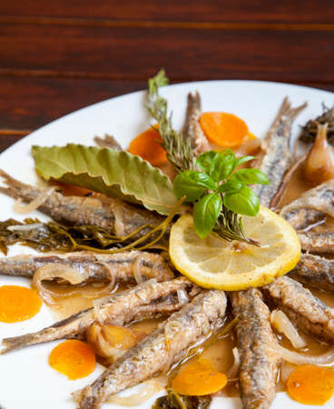 Tasty Marinated sardines with Mediterranean herbs, close up, space for text
