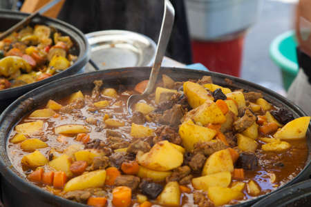 Stir Traditional stew,  farm-style with fresh meat, chicken, potatoes and vegetables photo