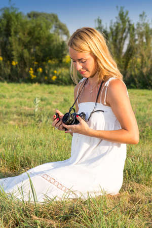 sexy pictures: Pretty blonde woman with vintage camera, in the park on sunny summer day