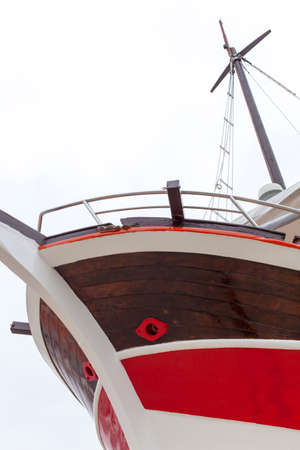 ship bow: Front view, bow, of fresh painted vintage wooden ship Stock Photo
