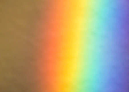 grounding: Natural Rainbow, prismatic effect, Photo taken by refraction of light through a prism on white grounding, background, close up