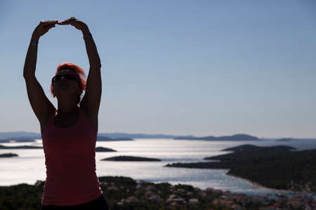kornati: Pretty woman, silhouette, enyojing, excercising on sea coast in Kornati national park, paradise islands, archipelago in Dalmatia, Croatia, space for text
