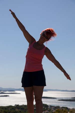 kornati national park: Pretty woman, silhouette, enyojing, excercising on sea coast in Kornati national park, paradise islands, archipelago in Dalmatia, Croatia, space for text