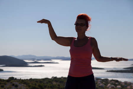 kornati national park: Pretty woman, silhouette, enyojing, excercising on sea coast in Kornati national park, paradise islands, archipelago in Dalmatia, Croatia, space for text