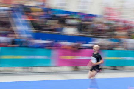 unrecognizable person: Marathon runner, blur and motion effect, unrecognizable person and logos