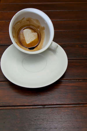 divination: Cup of coffee with Heart of Coffee Grounds, on wooden table, fortunetelling, divination symbol of love Stock Photo