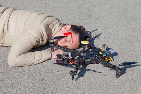 attacked: Pretty woman attacked by drone quadrocopter with bleeding head injuries,  lying on sidewalk in the city