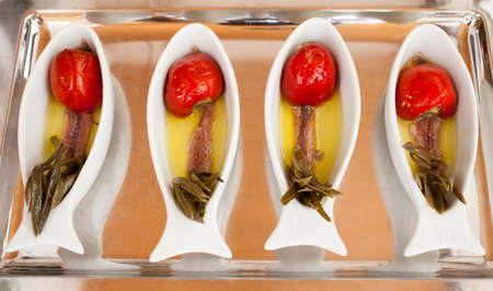 Salted anchovy fillets tasty served with Mediterranean spices and herbs Stock Photo