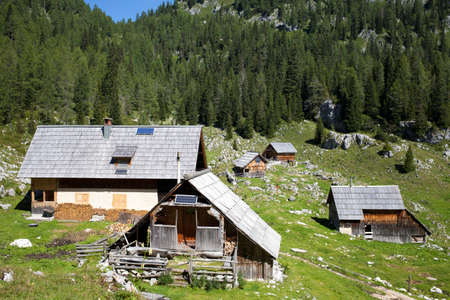 herdsman: Traditional herdsman wooden hut with solar panels, high in the Alps, on beautiful sunny day Stock Photo