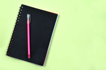 a pink pen is over a diary ready to write