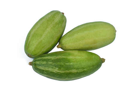 Fresh three green colored pointed gourd stacked on a white background 写真素材