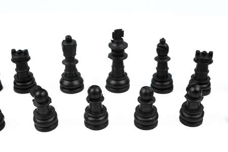 Eight different black color pawns placed on top of a white isolated empty background
