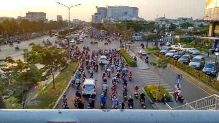 Ho-Chi-Minh-City (Saigon), Vietnam, 21st March 2016. Traffic jam at evening rush hour while sunset. Streets are filled with an uncountable number of motorbikes, cars, bus and trucks. Editorial