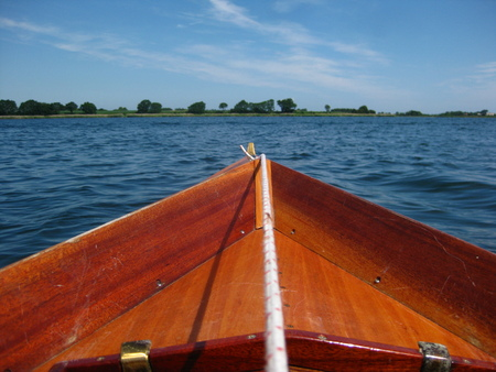 View from a rower in rowboat, looking to the blue sea. Stock Photo