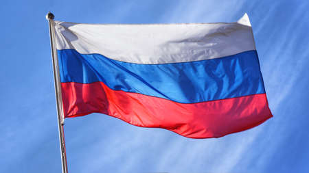 russian flag: Flag of Russia. Russian Flag on Flagpole Waving in front of Blue Sky.