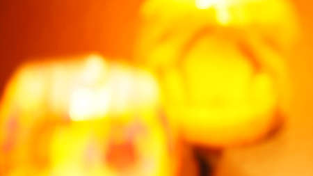 colores calidos: Unfocused blurred glasses in an abstract background in orange yellow red warm colors Foto de archivo