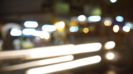 Blurred Car Lights and Unfocused Lamps in the Street in the Night
