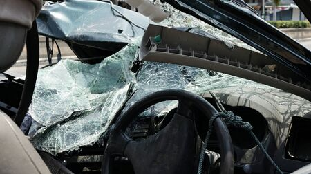 Destroyed windshield and front part of car after fatal accident.