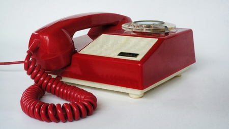 Telephone. Old red chinese phone. Photography of vintage fix line phone.