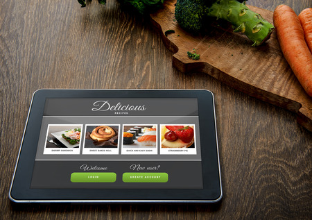 digital book: Cooking recipe on tablet pc with vegetables on backround