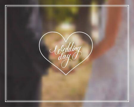 wedding bouquet: Wedding day typography element on blurred background. Wedding bouquet in brides and grooms hands.