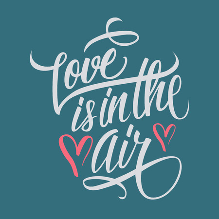 Love is in the air hand lettering. Hand drawn card design. Handmade calligraphy.