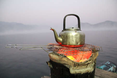 Boil the kettle on the stove time the fog on the water.