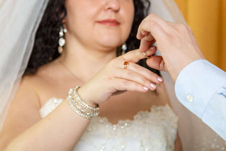 The groom putting the bride on the index finger at a Jewish wedding close-up.