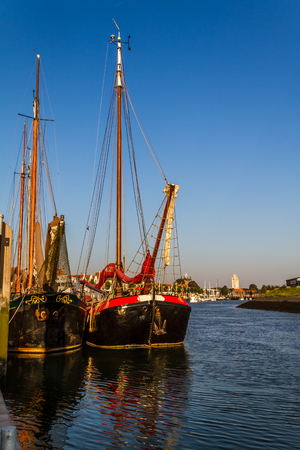 Historical sailing freightships in the harbor of Zierikzee, south holland photo