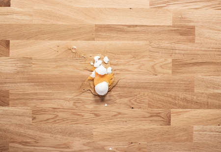 Broken egg on a wooden table