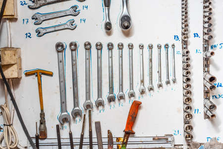 Tools systematically arranged on a wall. Stock fotó