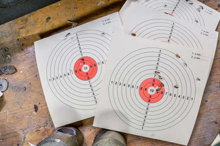 Shooting targets lying on a bench Stock Photo